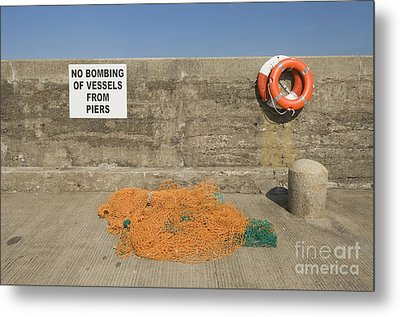 Harbor With Netting And Live Preservers Metal Print by Iain Sarjeant
