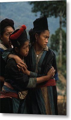 Hmong Girls Cling To Each Other Metal Print by W.E. Garrett
