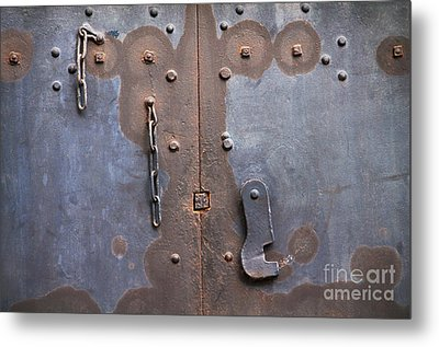 Hooked And Chained Metal Print by Dan Holm