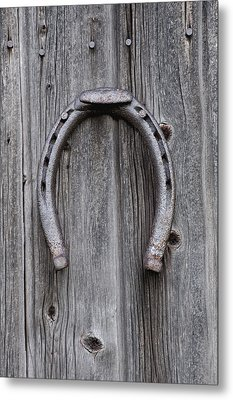 Horseshoe Hanging On A Wooden Wall Iron Metal Print by David Chapman