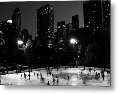 Ice Skating In Central Park Metal Print by Michael Dorn