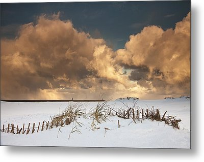 Illuminated Clouds Glowing Above A Metal Print by John Short