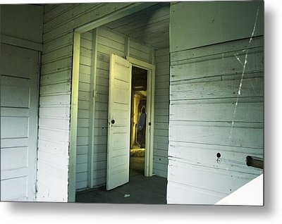 In A Cottage Metal Print by Janet Kearns