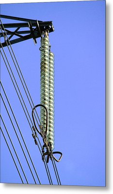 Insulators On An Electricity Pylon Metal Print by Paul Rapson