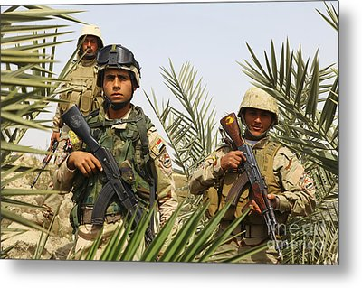 Iraqi Soldiers Conduct A Foot Patrol Metal Print by Stocktrek Images