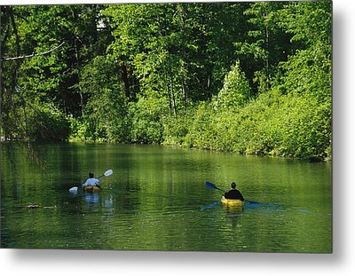 Kayakers Paddle In The Headwaters Metal Print by Raymond Gehman