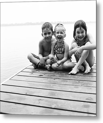 Kids Sitting On Dock Metal Print by Michelle Quance