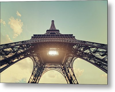 Light Shining Through Eiffel Tower Metal Print by Philipp Klinger
