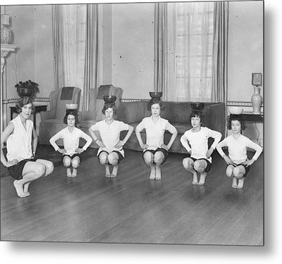 Line Of Girls (7-12) Exercising With Bowls On Heads (b&w) Metal Print by Hulton Archive