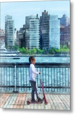 Little Girl On Scooter By Manhattan Skyline Metal Print by Susan Savad