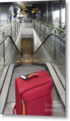 Luggage At The Top Of An Escalator Metal Print by Jaak Nilson