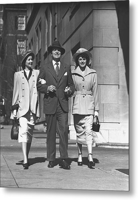 Man And Two Women Walking On Sidewalk, (b&w) Metal Print by George Marks