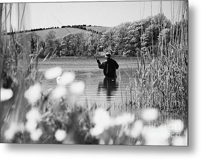 Man Flyfishing On Lake In Ireland Metal Print by Joe Fox