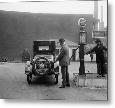 Man Fueling His Car At A Self-service Metal Print by Everett