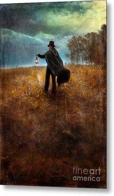 Man In Top Hat And Cape Walking In Rain Metal Print by Jill Battaglia