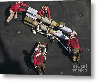 Marines Push Pordnance Into Place Metal Print by Stocktrek Images
