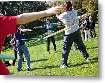 Michelle Obama Hula Hoops With Children Metal Print by Everett