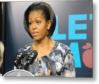 Michelle Obama Presents The Childhood Metal Print by Everett