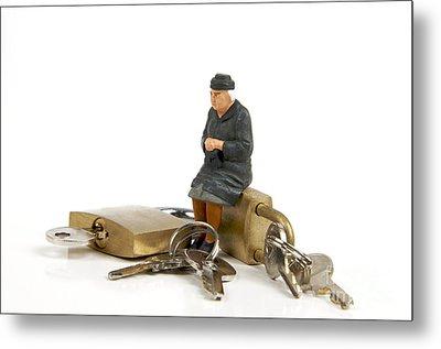 Miniature Figurines Of Elderly Sitting On Padlocks Metal Print by Bernard Jaubert