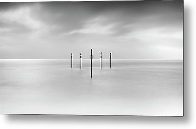 Minimal Posts Are Arranged Symmetrically In Sea Metal Print by Doug Chinnery