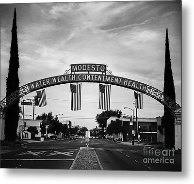 Modesto Arch With Flags Metal Print by Jim And Emily Bush