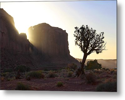 Monument Valley At Sunset Metal Print by Mike McGlothlen