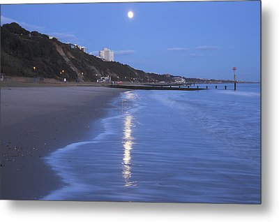 Moon Reflecting In The Sea, Bournemouth Beach, Dorset, England, Uk Metal Print by Peter Lewis