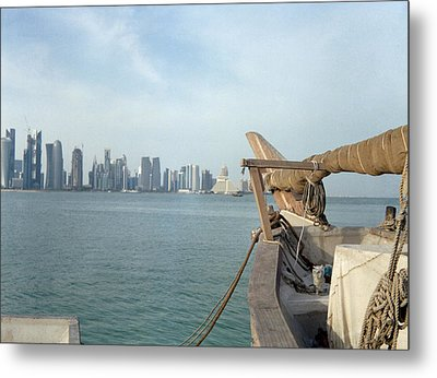 Moored Dhow And Doha Metal Print by Paul Cowan