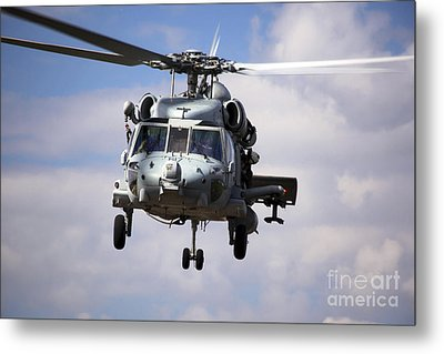 Navy Pilots In A Sh-60f Seahawk Conduct Metal Print by Michael Wood