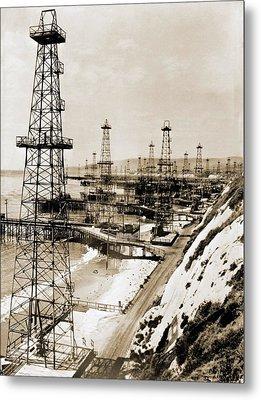 Oil Well Derricks On The Beach Metal Print by Everett