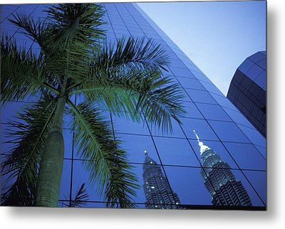 Palm Tree And Reflection Of Petronas Metal Print by Axiom Photographic