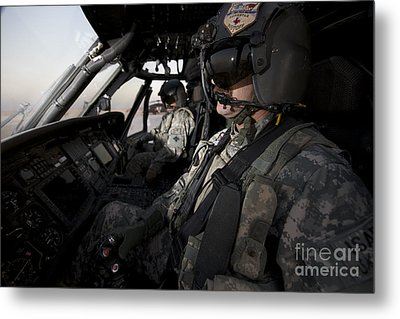 Pilot In The Cockpit Of A Uh-60l Metal Print by Terry Moore
