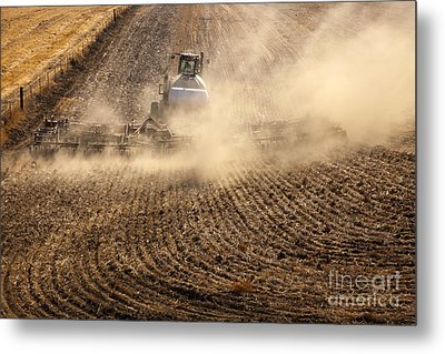 Plowing The Ground Metal Print by Mike  Dawson
