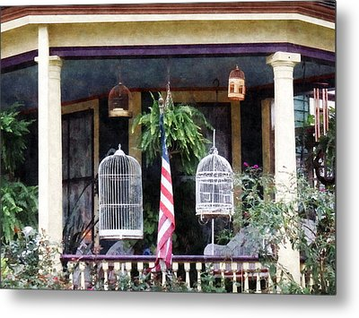 Porch With Bird Cages Metal Print by Susan Savad