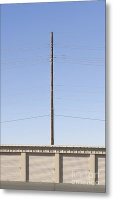 Power Line Pole Over Bay Doors Metal Print by Dave & Les Jacobs