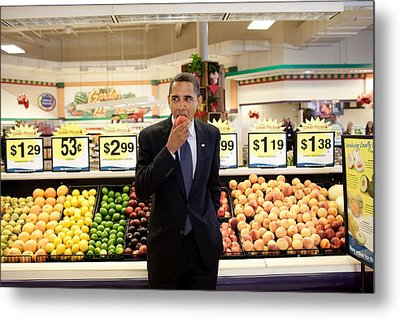 President Barack Obama Eats A Peach Metal Print by Everett