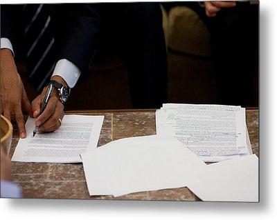 President Barack Obama Works Metal Print by Everett