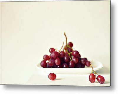 Red Grapes On White Plate Metal Print by Photo by Ira Heuvelman-Dobrolyubova