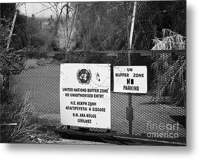restricted area of the UN buffer zone in the green line dividing north and south cyprus in nicosia Metal Print by Joe Fox