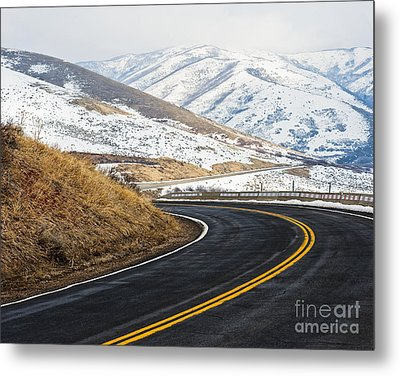 Road Through A Snowy Mountain Landscape Metal Print by Thom Gourley/Flatbread Images, LLC