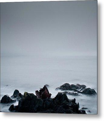 Rocks In Water At Sea Metal Print by Ahfox21