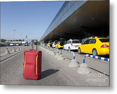 Rolling Luggage Outside An Airport Terminal Metal Print by Jaak Nilson