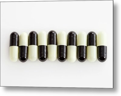 Row Of Black And White Pills Metal Print by Schedivy Pictures Inc.