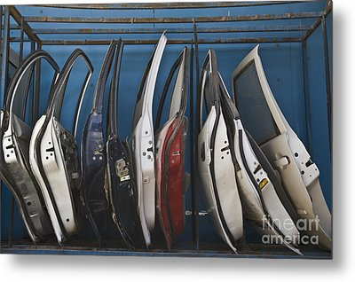 Row Of Dismantled Car Doors Metal Print by Noam Armonn