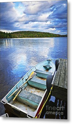 Rowboat Docked On Lake Metal Print by Elena Elisseeva
