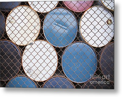 Rows Of Stacked Barrels Behind A Fence Metal Print by Paul Edmondson
