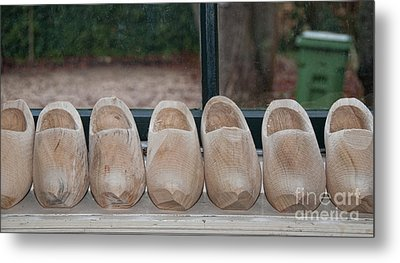 Metal Print featuring the digital art Rows Of Wooden Shoes by Carol Ailles