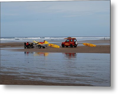 Metal Print featuring the photograph Safe On The Beach by Lynn Hughes