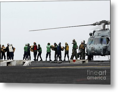 Sailors And Marines Load Supplies Onto Metal Print by Stocktrek Images