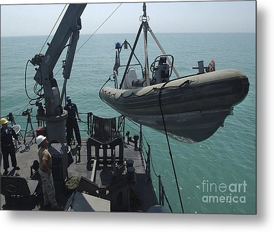 Sailors Lower A Rigid Hull Inflatable Metal Print by Stocktrek Images
